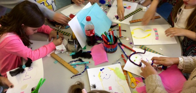 The children showed their family how to make puppets.
